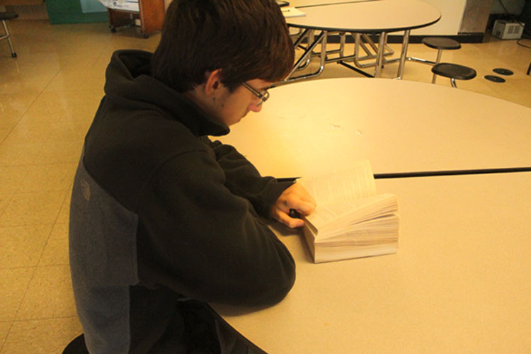Former student Brian Baldwin spends his free time reading and studying in the student cafe during 2nd period.