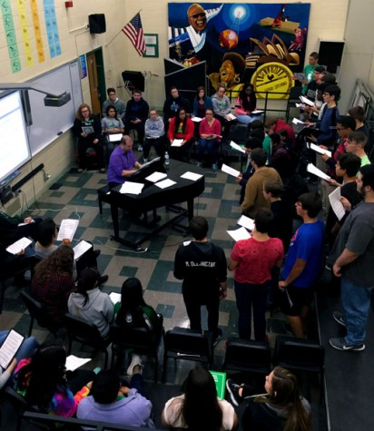 The OLCHS choir preparing for performances as a whole. On November 23, 2015 conducted by Mr. Baglione in his choir room.