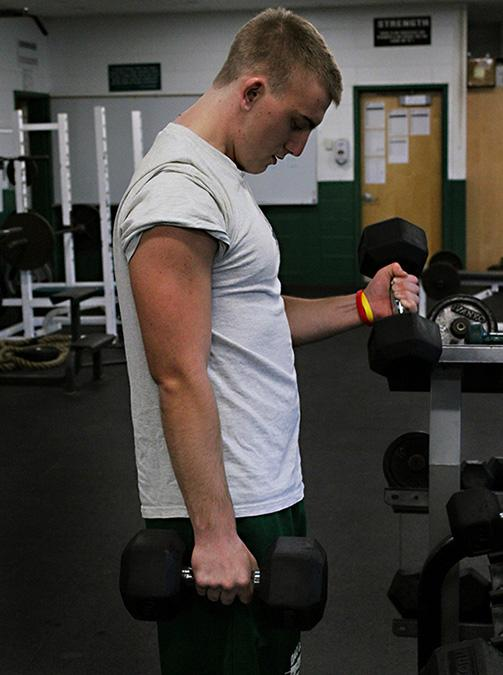 John Konopinski of Mr. Probst's second period class, reps out a set of bicep curls on November 20th.