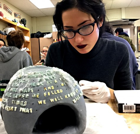 A Charles Bukowski poem is transferred into Kaeley Clark's artwork on November 24th in Mrs. Clark's class to complete her project.