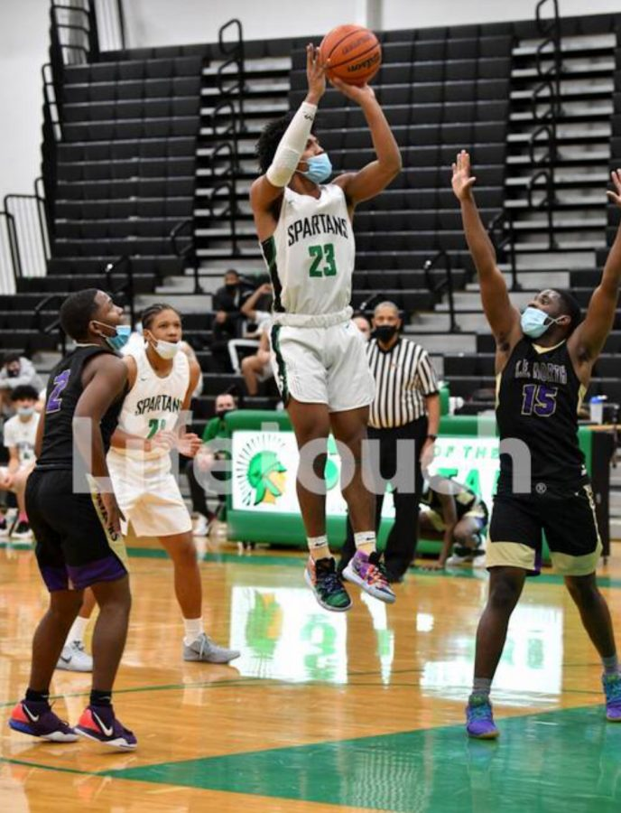 Boys Basketball Steps Up To The Pressure